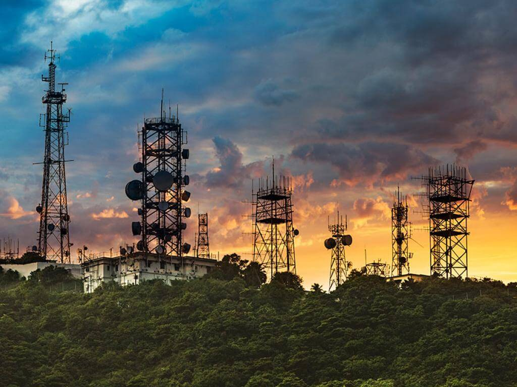 radio and cellular towers against the sky