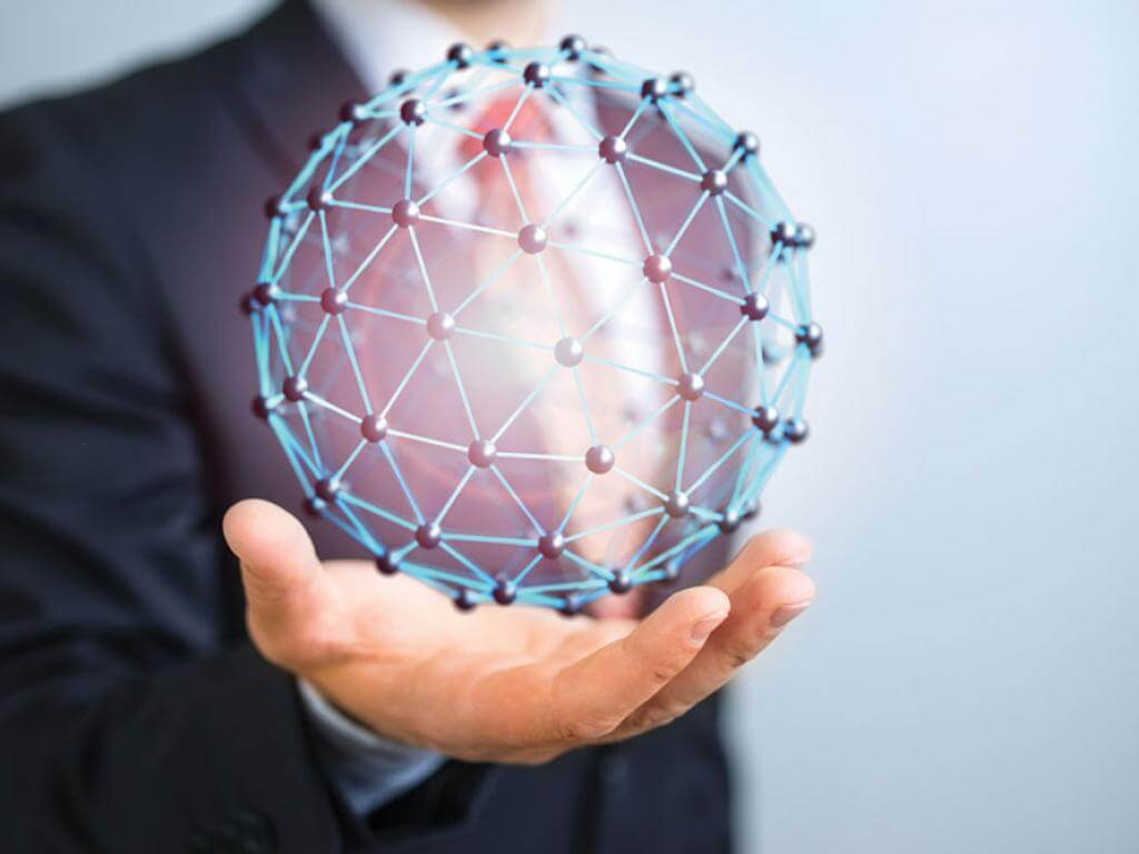 Business professional's hand holding a computer-generated sphere