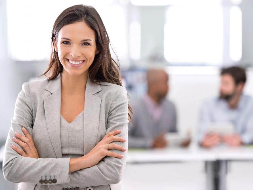 Smiling woman demonstrating leadership in a meeting