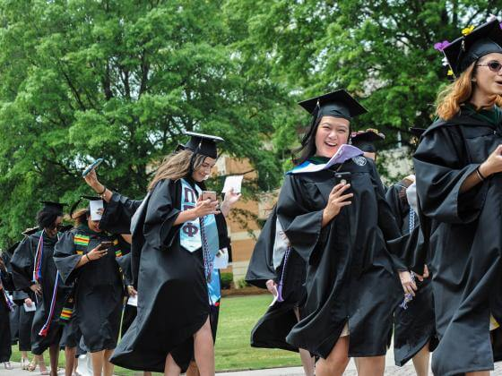 ODU graduates walk across the seal on commencement day
