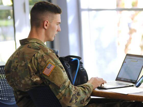 Military student on computer