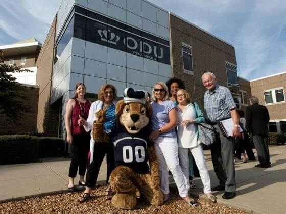 Big Blue and staff outside the ODU Tri-Cities Higher Education Center