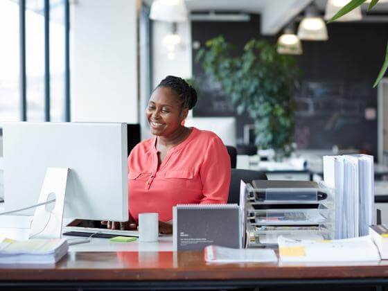 Woman working at desk in an open office