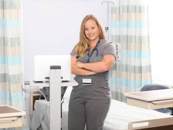 Nurse stands in clinic environment