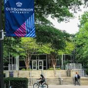 main campus with students walking and ODU flag