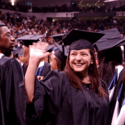 Graduate at Commencement Waving